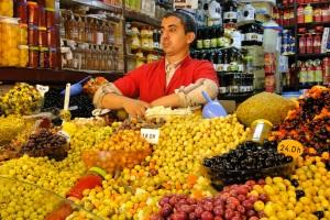 Olive_Seller_in_Market_-_Tangier_-_Morocco